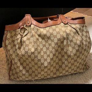Gucci travel bag.
